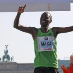 Makau of Kenya crosses the finish line to win the 38th Berlin Marathon in Berlin